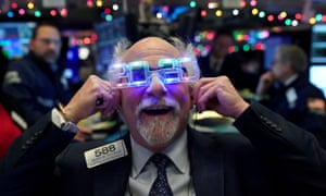 Trader Peter Tuchman wears 2020 glasses to celebrate the New Year at the New York Stock Exchange, 31 December 2019.
