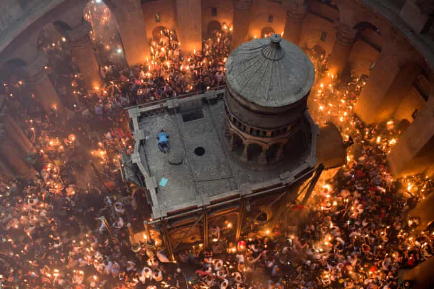 Worshippers congregate outside the tomb of Christ during the miracle of the holy fire on 30 April 2016.