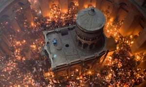 Orthodox Christian worshippers at the Tomb of Christ during the miracle of the Holy Fire in the Church of the Holy Sepulchre, Jerusalem. David Lowenthal cited the church as an example of how different cultures imagine their own heritage.