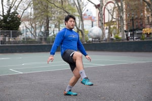 """Alex Kim, 24-years-old, juggling a soccer ball at a park on Broome Street and Christie Street in Manhattan. """"I'm just working out as best I can with the space and equipment that I have because the gyms are closed. I'm learning how to juggle a soccer ball. I've made some progress, but I'm not where I want to be. Juggling is kind of a by yourself type of thing, so it's good for right now. I've been learning for around two weeks. This is the only space in my neighborhood that is open."""""""