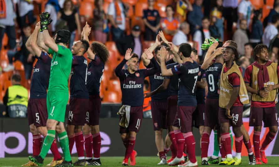 Arsenal celebrate with their fans after qualifying for the Euopa League final with a 4-2 win at Valencia.