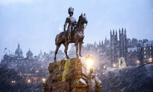 Snow falling on the Royal Scots Greys monument in Edinburgh on Boxing Day.