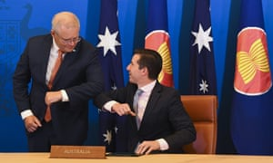 Australian Trade Minister Simon Birmingham (right) and Australian Prime Minister Scott Morrison react after signing the Regional Comprehensive Economic Partnership (RCEP) during a virtual signing ceremony at Parliament House in Canberra, Sunday, November 15, 2020.