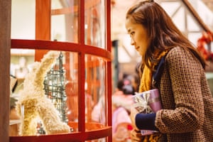 Young lady looking at christmas window display