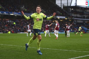 Wilson celebrates as the Burnley players remonstrate with Mike Dean.