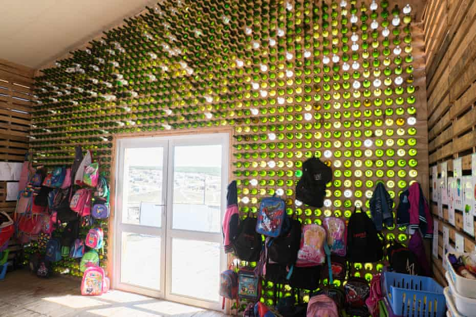 Glass wall built with recycled wine bottles