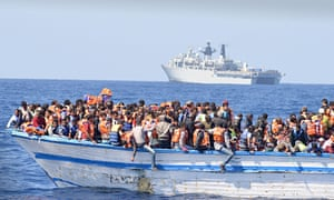 An overcrowded boat in waters north of Libya last year.
