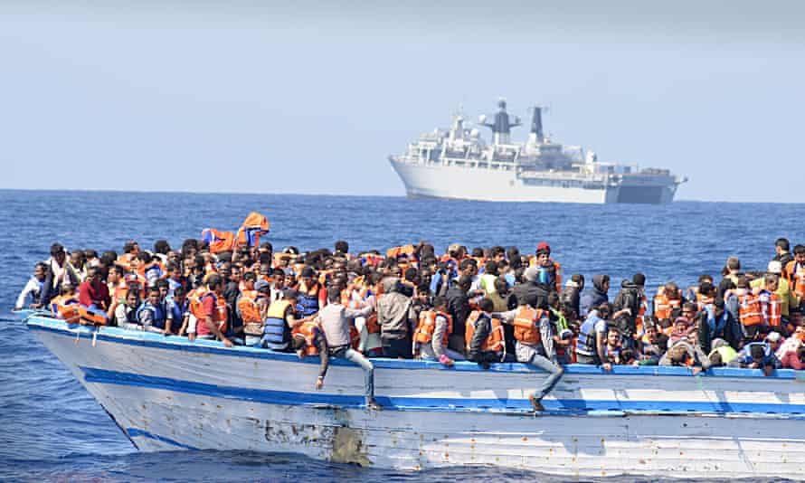 369 migrants crammed into a heavily overcrowded wooden hulled boat which was located in the waters just north of Libya.