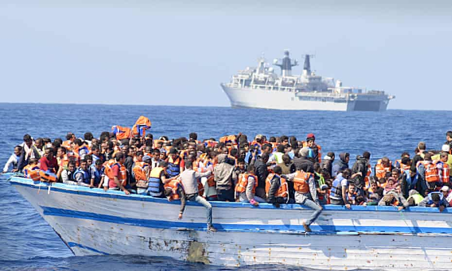 Refugees on an overcrowded  boat found in waters north of Libya