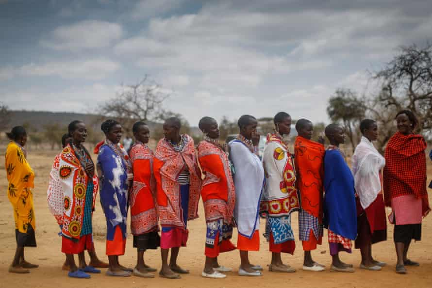 Maasai women wait in line to cast their votes at a polling station in Iloodokilani in Kajiado county, 100km south of Nairobi.