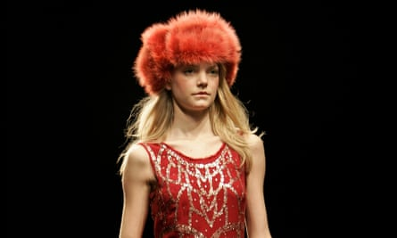 A model wears a fur hat on the catwalk during a previous London fashion week.