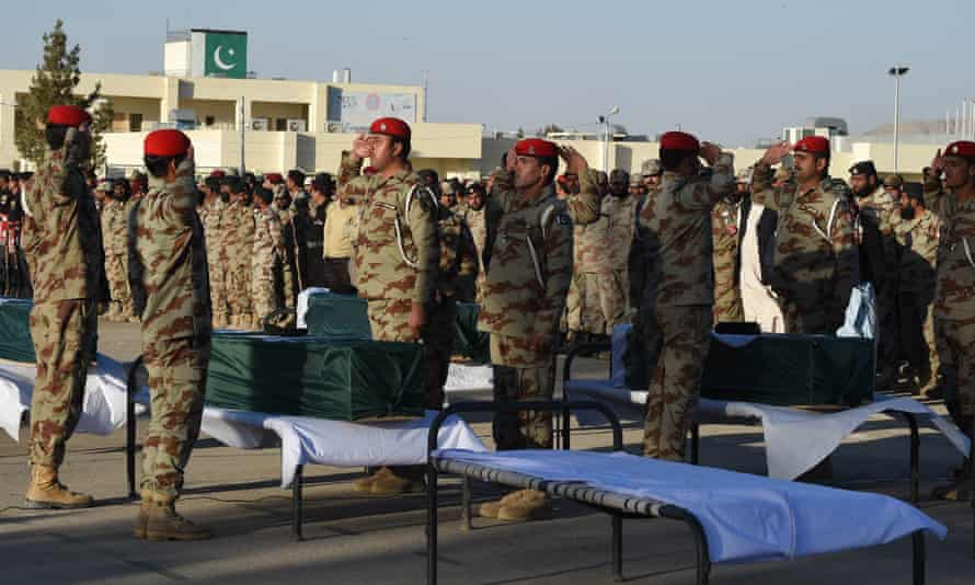 Pakistani paramilitary soldiers last month salute the coffins of colleagues killed in a roadside blast in Quetta, the capital of Balochistan province