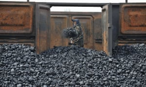A Chinese coal worker at a storage site along in Shenyang, Liaoning province