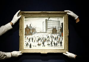 London, UK Employees pose with The Mill, Pendlebury 1943 by L.S. Lowry, on display at Christie's auction house. The item is expected to sell for £700,000-£1,000,000 when it goes on sale in the Modern British Art Evening Sale