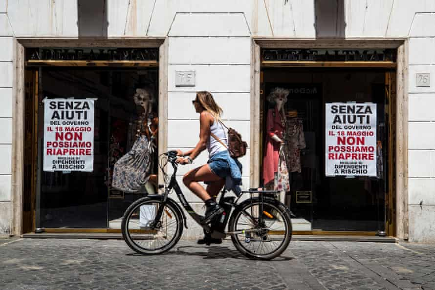 A sign in a shop window in Rome demanding Italian government help it to reopen after the coronavirus lockdown