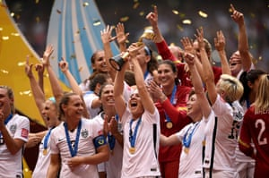 USA lift the World Cup trophy.