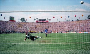 Italy's Roberto Baggio sends the ball high over the crossbar and the head of Brazilian goalkeeper Claudio Tafarrel in the 1994 World Cup final.