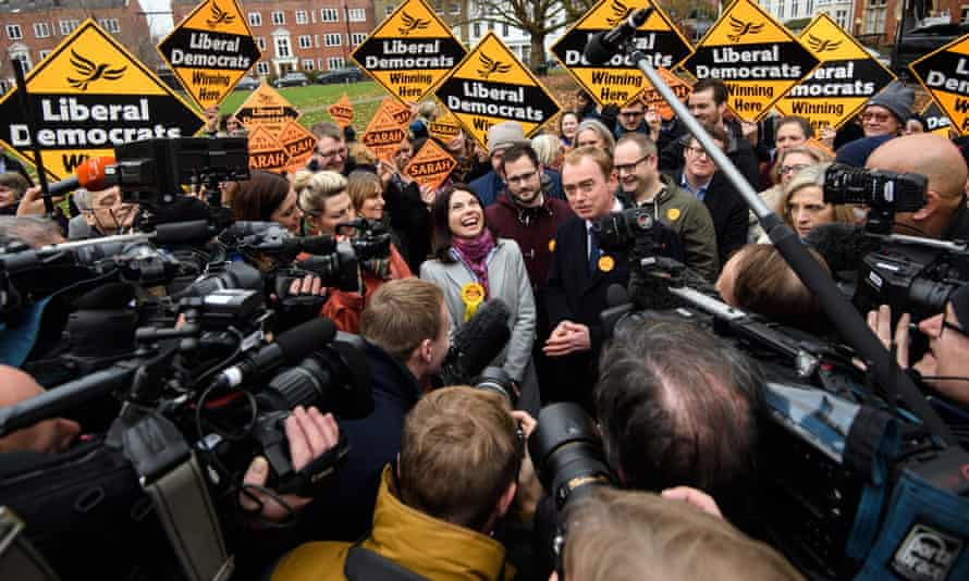 Sarah Olney and Lib Dem leader Tim Farron surrounded by journalists after her byelection win
