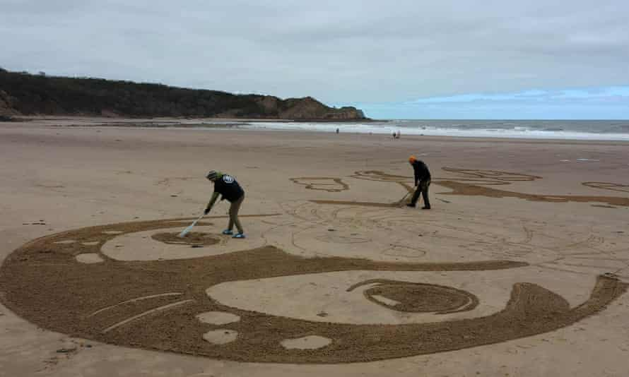 The 50-metre sand drawing being created by Sand In Your Eye for Surfers Against Sewage's new Million Mile Beach Clean campaign, on Cayton Bay in Yorkshire.