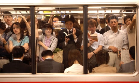 Game of thrones: commuter sells seat on crowded Tokyo train