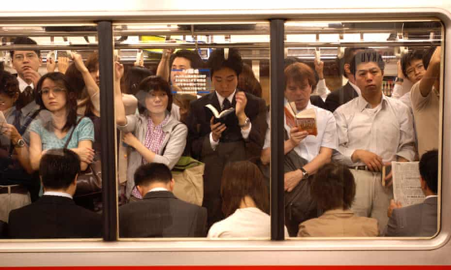 Commuters on the Tokyo subway.