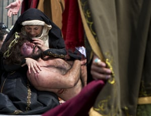 Actors perform the roles of Mary and Jesus in a re-enactment in Mexico City's main square.