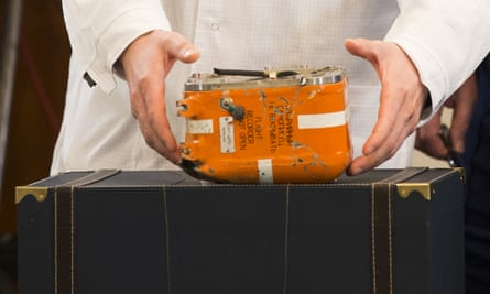 Russian officials opened the plane's orange flight recorder in Moscow on Friday in front of reporters and diplomats.