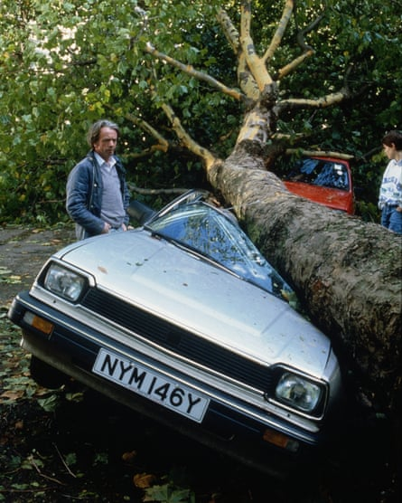 A car is crushed by a falling tree during the great storm of 1987.