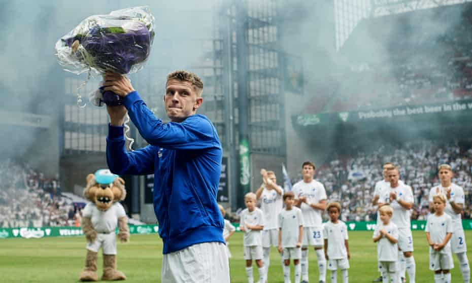 Jens Stage accepts a bouquet of flowers prior to the Danish Superliga match between FC Copenhagen and AGF Aarhus on 19 July, five days after Stage's flat was set on fire
