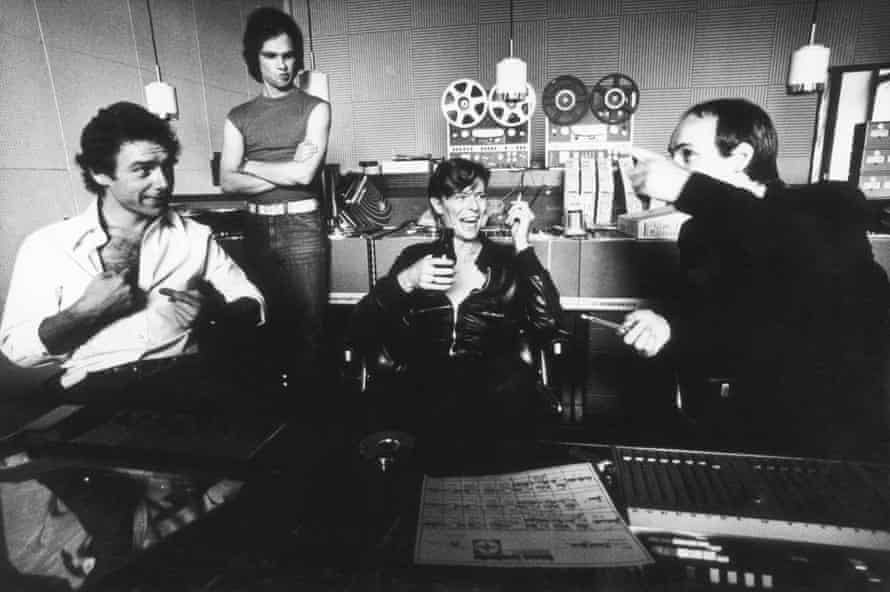 David Bowie at Hansa Tonstudio with Robert Fripp, left, and Brian Eno, right, in July 1977.