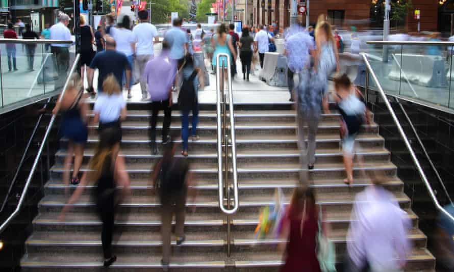 People walking from Martin Place Station, Sydney, Sunday, December 31, 2017.