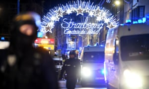 Police officers stand guard near the Christmas market where a shooting took place in Strasbourg, France