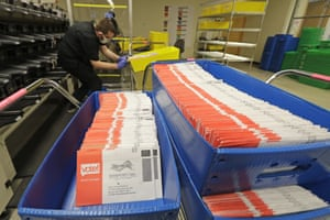 Vote-by-mail ballots are shown in sorting trays at the King County Elections headquarters in Renton, Washington.