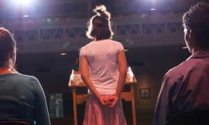 Back view of anxious-looking young person giving speech