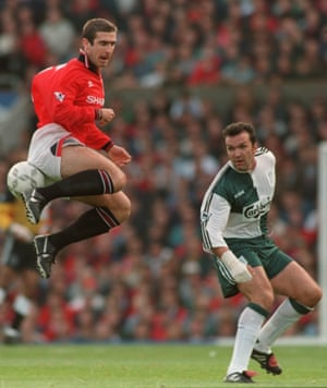 Eric Cantona tries a trick on his comeback in 1995 as Neil Ruddock watches on.