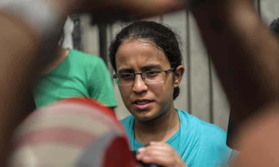 Egyptian student Mariam Malak, 19, talks to the media outside the Forensic Medical Authority headquarters in Cairo.