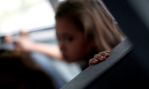 A Central American child is seen inside a van after she arrive at a shelter which gives temporary shelter to asylum seekers released by Ice and US Customs and Border Protection in Laredo, Texas earlier this month.