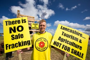 A protestor against fracking at a farm site at Little Plumpton near Blackpool, Lancashire, UK