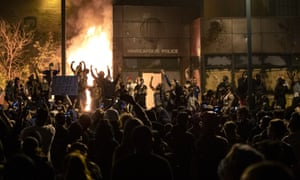 Protesters gesture after the Minneapolis police 3rd Precinct building was set on fire on Thursday night