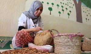 Khaltoum Alta, a member of the Ajddigue women's argan co-operative in the village of Tidzi, sorts argan nuts