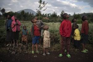 Children watch a drone flying near the Volcanoes national park in Kinigi, Rwanda.