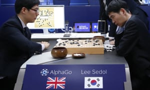 South Korean professional Go player Lee Sedol, right, reviews the match