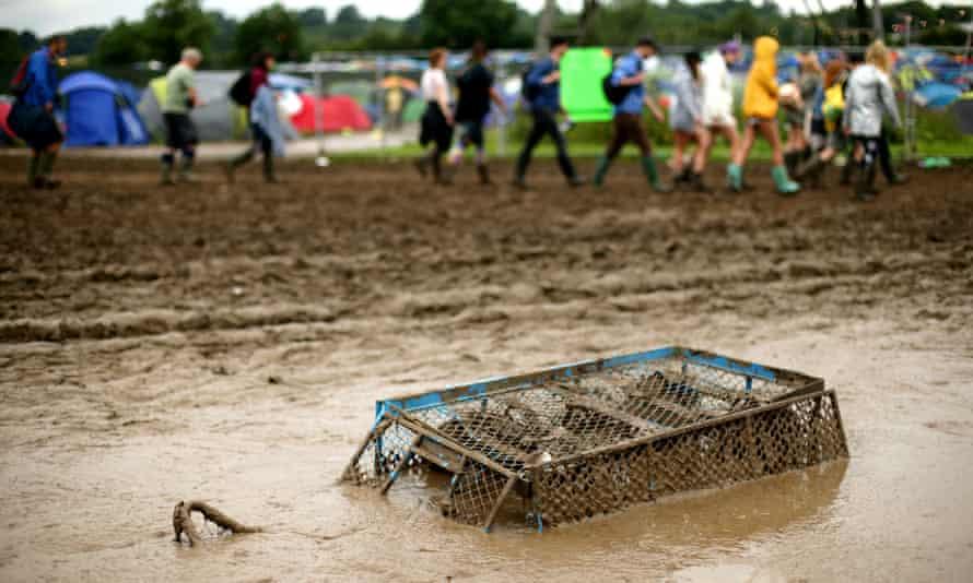 A trolley submerged in mud at Glastonbury 2016.