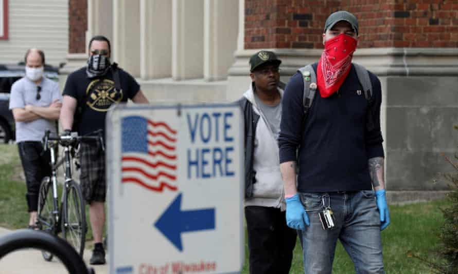 Voters wait to cast ballots during the presidential primary election in Wisconsin on Tuesday.