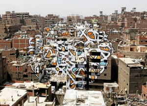 A huge mural by French-Tunisian artist El Seed covers several buildings in the shanty town of Zaraeeb on the outskirts of Cairo, a centre for urban refuse and recycling services known as 'Garbage City'