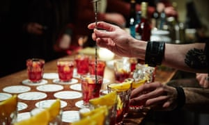 A close-up image of a table in a London cocktail bar filled with negroni cocktails.