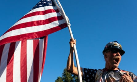A protester waves an American flag during a rally in Gresham, Oregon, last week. Rightwing demonstrators opposed the city's decision to fly a BLM flag from city hall.