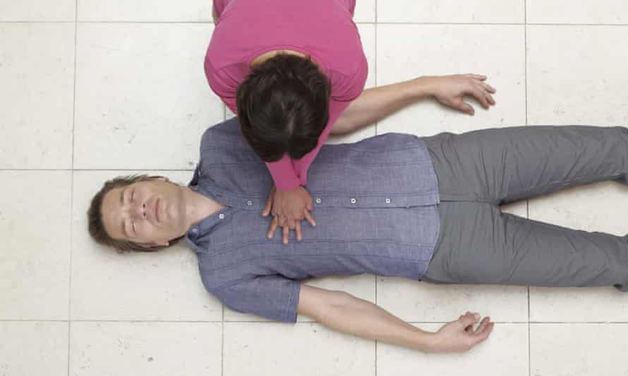 A woman performs CPR