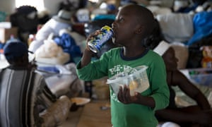 A boy eats at the Full Gospel church in Sand Banks, on 9 September 2019 in Great Abaco, Bahamas.
