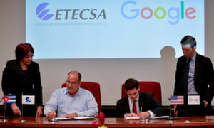 The vice-president of Cuba's state-run telecommunications company ETECSA and the head of Google Cuba sign a memorandum of understanding in Havana Thursday.